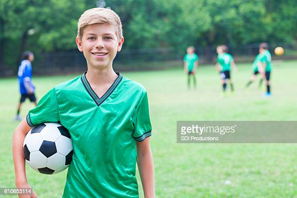 Handsome Caucasian soccer player with ball