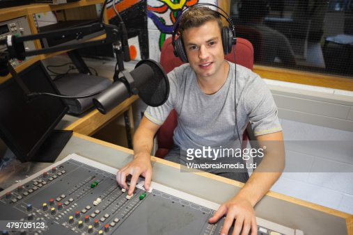Handsome cheerful radio host moderating : Stock Photo