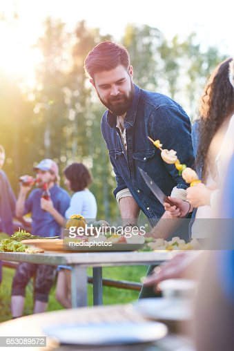 Handsome chef cooking : Stock Photo