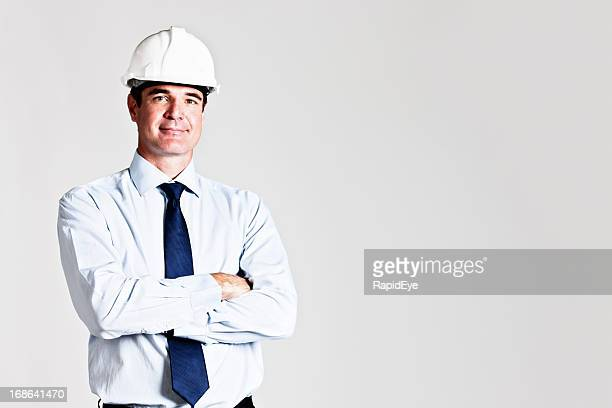 Handsome construction boss engineer or architect smiles at camera
