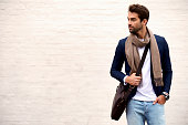 Handsome dude in scarf and jacket, looking away