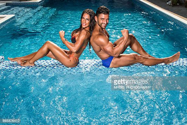 Handsome Fit Couple at the Swimming Pool
