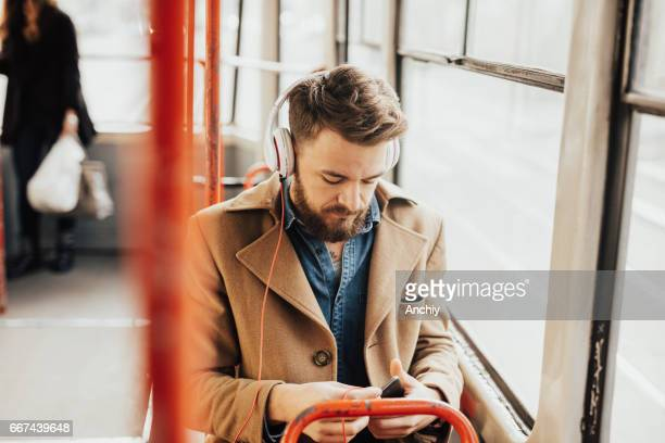 Handsome guy listening to the music on public transport