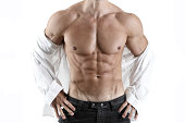 Handsome muscular male posing in front of a white background