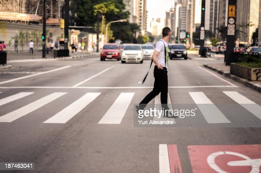 Handsome guy walking on  a evening city street
