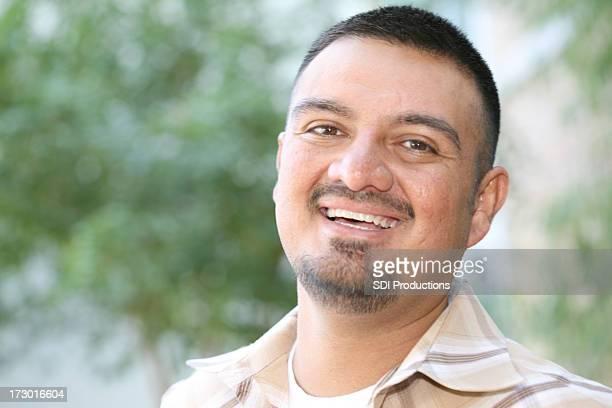 Handsome Hispanic Male Having A Laugh