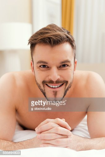 Handsome in bed. : Stock Photo