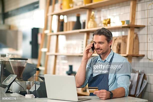 Handsome male barista making online order