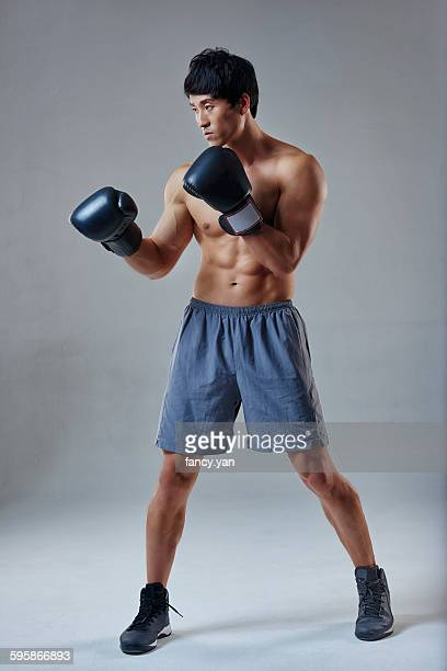 Handsome male is boxing