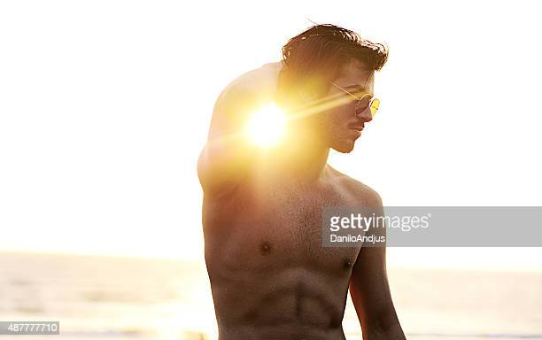 handsome male model at the beach