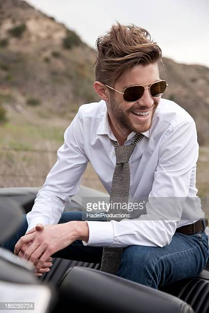 Handsome Male Model Sitting on Car Seat
