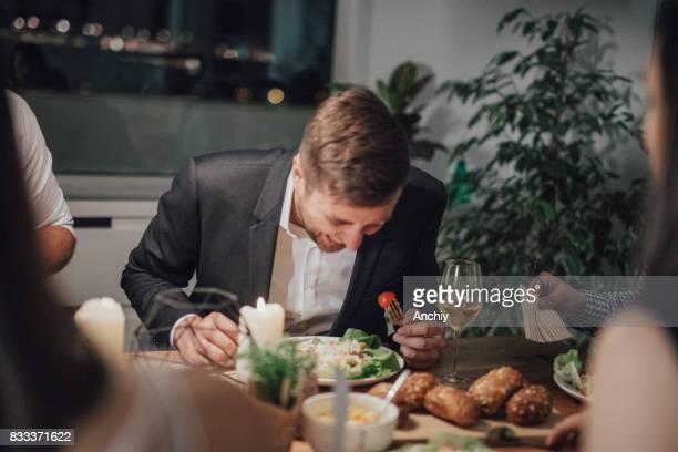 Handsome man burst into laugh during dinner.