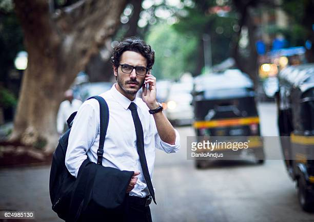 handsome man going back from work talking on his phone