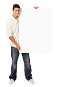 Handsome Man Holding Blank Sign - Isolated