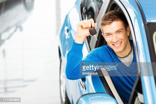 Handsome Man Holding Car Key