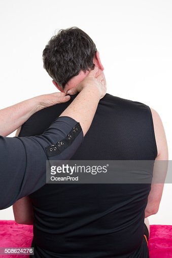 Handsome  man in a spa having a shoulder massage : Stock Photo