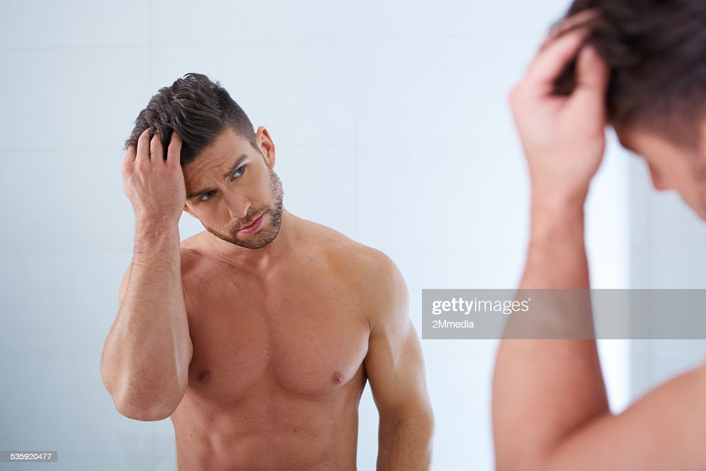 handsome man in his bathroom : Stock Photo