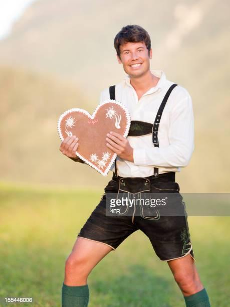 Handsome Man in Lederhose holding a Gingerbread Heart (XXXL)