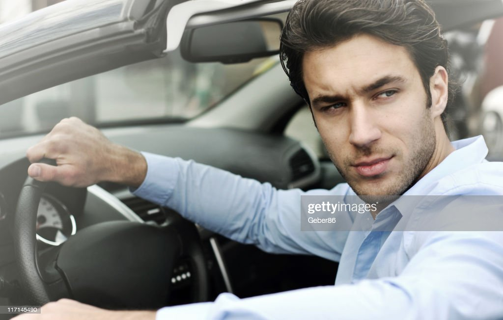 handsome man in the car : Stock Photo