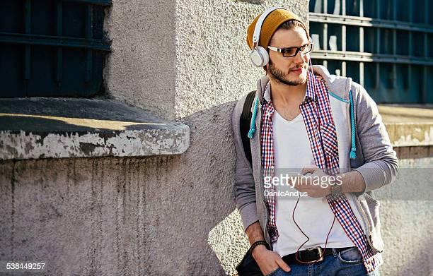 handsome man listening to music