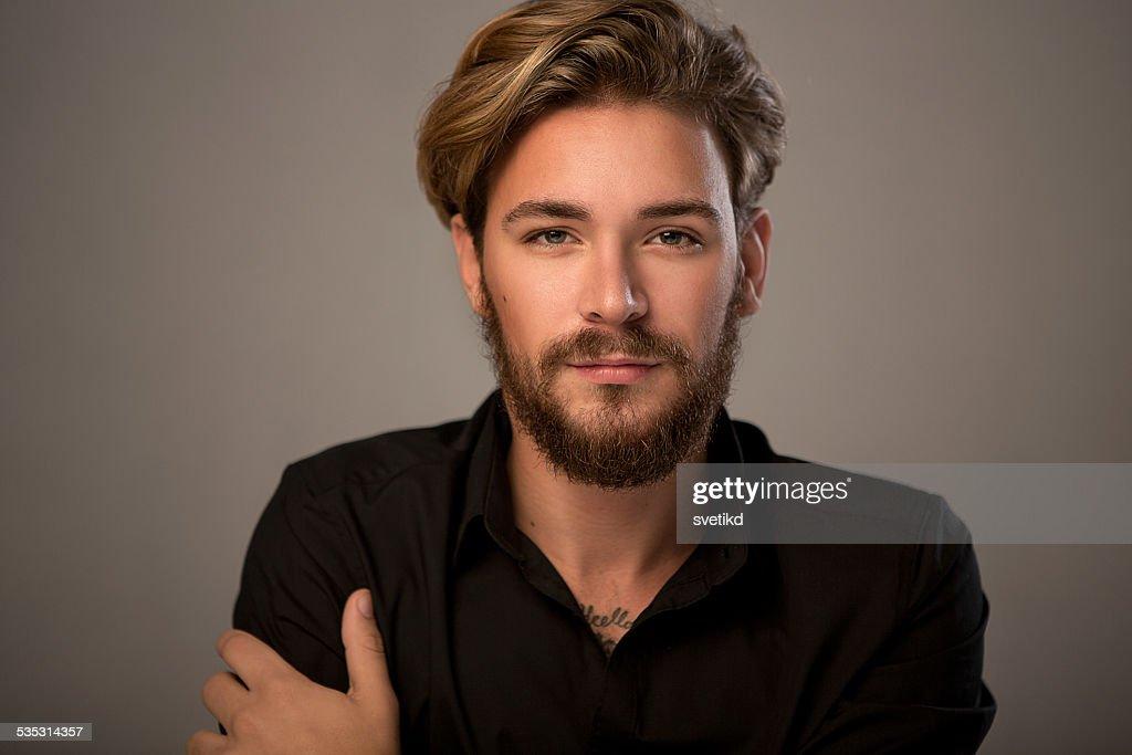 Handsome man looking at camera. : Stock Photo
