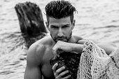 Handsome man on the wild beach.