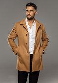 Portrait of sexy man in coat