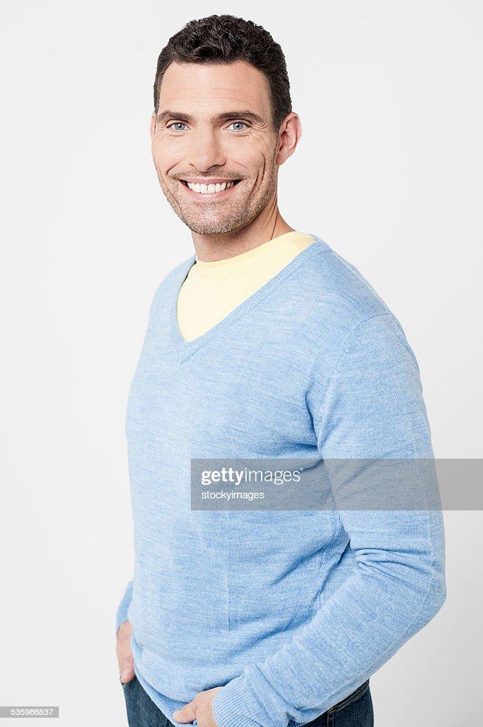 Handsome man posing casually : Stock Photo