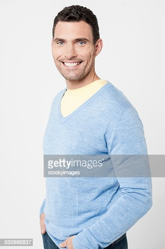 Handsome man posing casually : Stock Photo