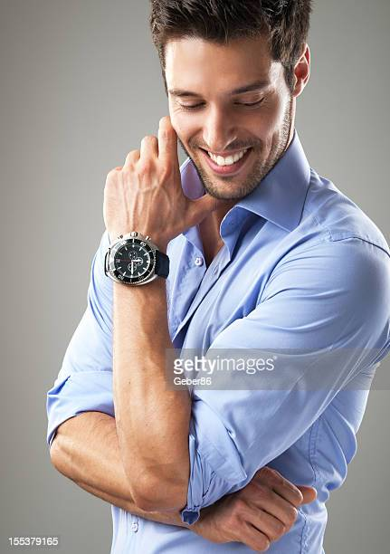 handsome man posing with watch