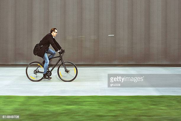Handsome man riding bicycle
