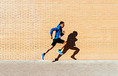 Handsome man running in the city. Fitness, workout, sport, lifestyle concept.