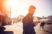 Handsome man sending text message