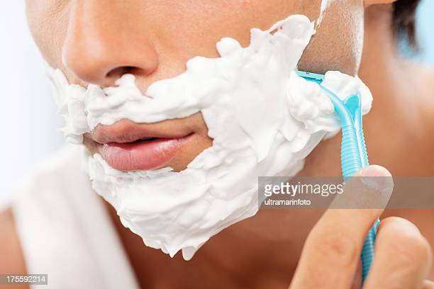 Handsome man shaving