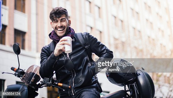Handsome man sitting on motorcycle