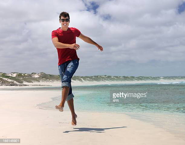 Handsome Man skipping down a secluded Beach (XXXL)