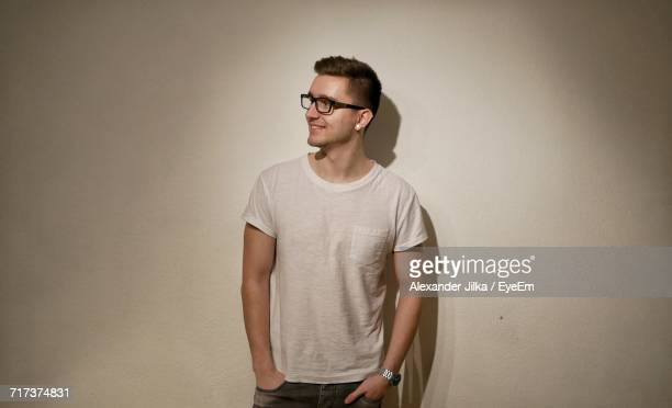 Handsome Man Standing Against White Wall