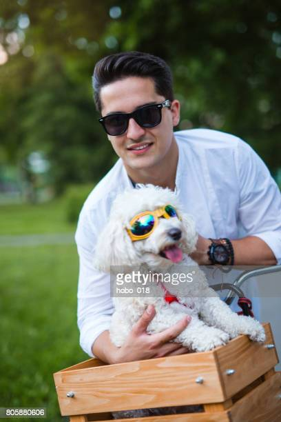 Handsome man with his dog on bicycle