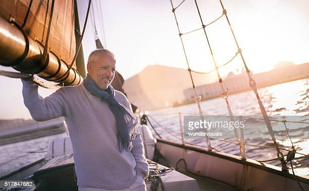Handsome Mature man on yacht in picturesque sunset