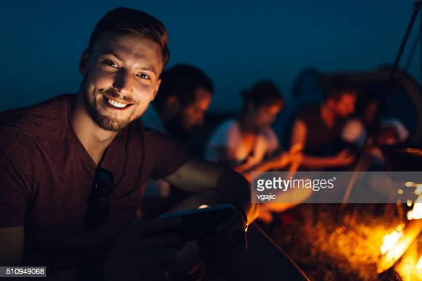 Handsome men camping with his friends