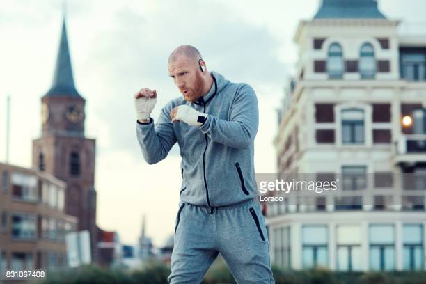 Handsome Middle Aged Bearded Man Exercising Outdoors in Northern Europe