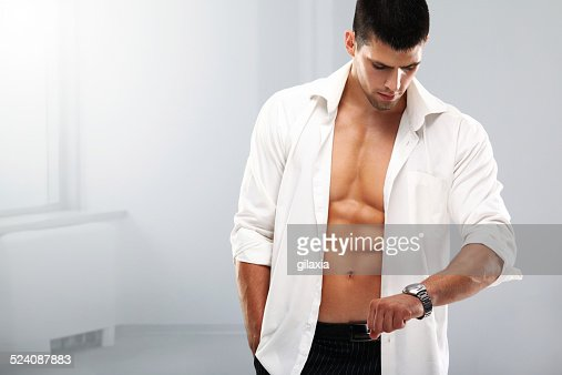 Handsome muscular man with a wristwatch.