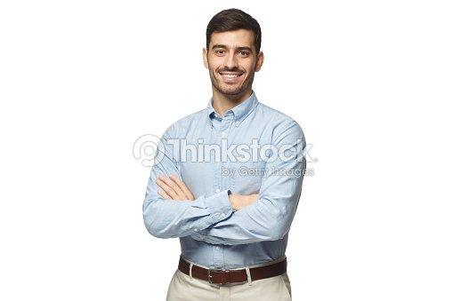 흰색 배경에 고립 된 교차 팔 파란 셔츠 서에서 잘생긴 웃는 사업가 : 스톡 사진
