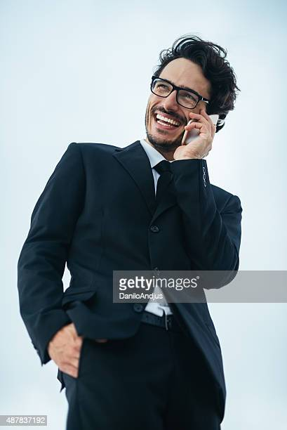handsome smiling businessman talking on the phone