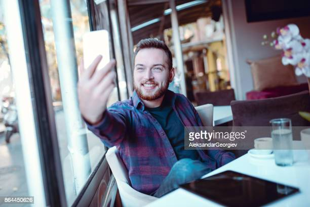 Handsome Smiling Man Taking Selfie At Home in Morning