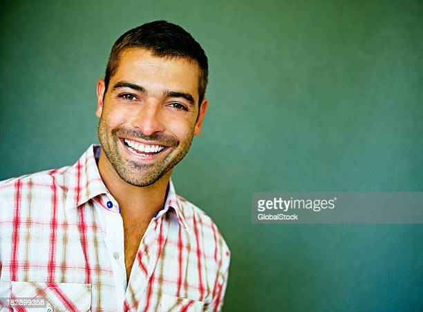 Handsome smiling man with dark hair and plaid shirt