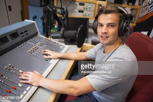 Handsome smiling radio host moderating : Foto stock