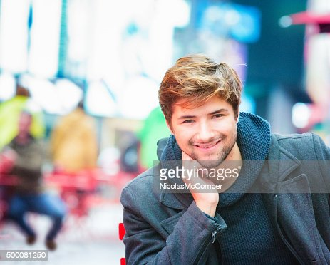 Handsome smiling young American urban portrait chin on hand : Stock Photo