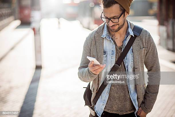 handsome stylish man using his smartphone