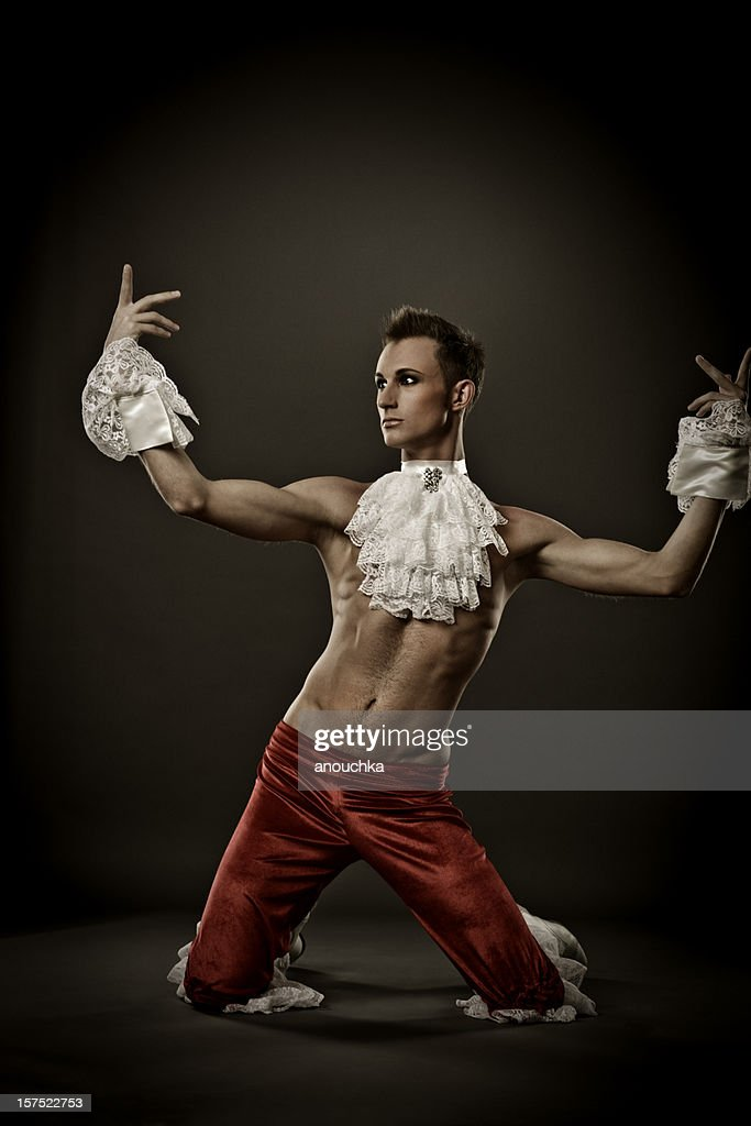 Handsome Young Actor in stage costume sitting on the floor : Stock Photo